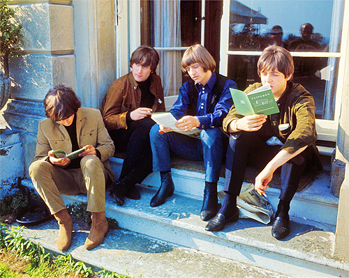 Three out of four Beatles read...