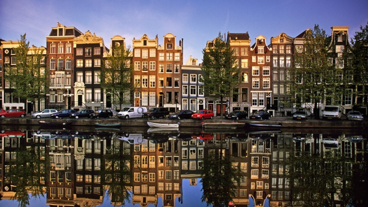 Netherlands Amsterdam Reflection of building in canal called Singel