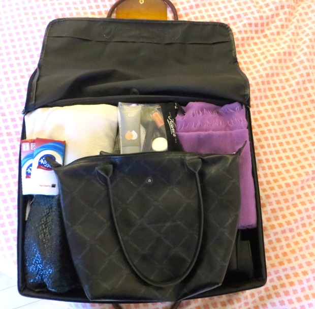 My trust Longchamp suitcase makes the carry-on cut. http://bit.ly/1CdpWHF